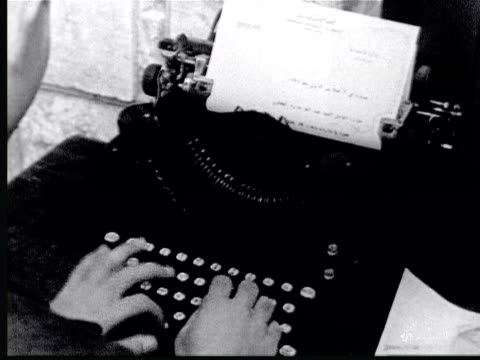 1925 B/W MONTAGE Hands typing on mechanical typewriter which writes in Arabic / Beirut, Lebanon