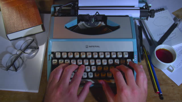 cu hands typing on retro typewriter on desk / new zealand - bok tryckt media bildbanksvideor och videomaterial från bakom kulisserna