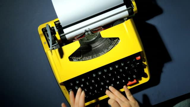 hands typing on yellow typewriter - typewriter keyboard stock videos & royalty-free footage