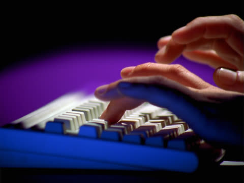 Hands typing with keyboard