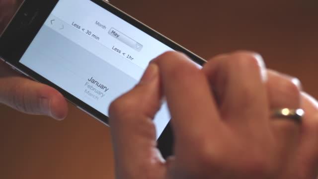 vídeos y material grabado en eventos de stock de hands using a smartphone with graphs of financial app - pantalla táctil