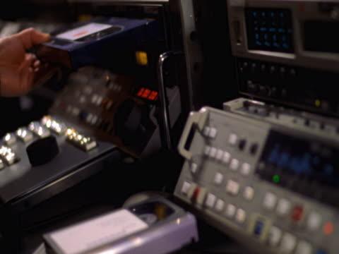 vidéos et rushes de hands using controls in tv control room - studio de télévision
