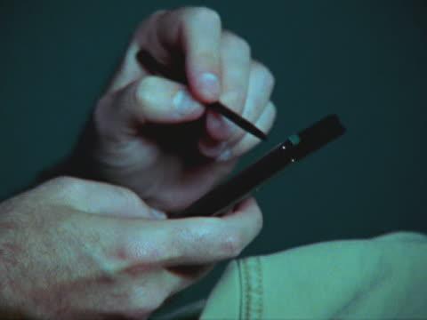 hands using palmtop computer - människofinger bildbanksvideor och videomaterial från bakom kulisserna