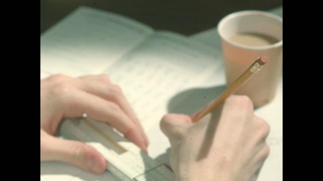 cu hands using slide rule, pencil, coffee cup - slide rule stock videos & royalty-free footage