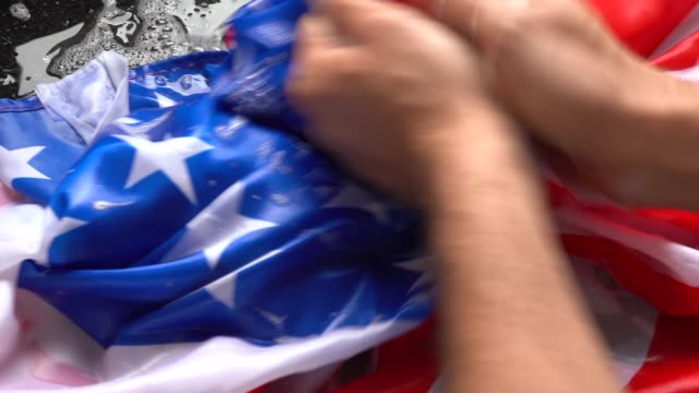 Hands Washing American Flag - Change USA/Corruption Concept