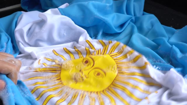 Hands Washing Argentina Flag - New Argentina/Corruption Concept