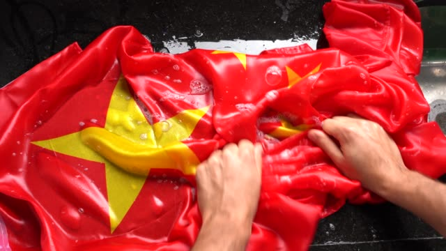hands washing chinese flag - change china/corruption concept - bribing stock videos and b-roll footage