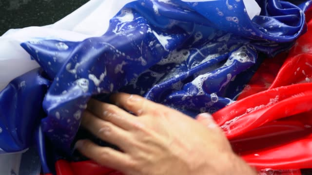 hands washing russian flag - change russia/corruption concept - corruption stock videos and b-roll footage
