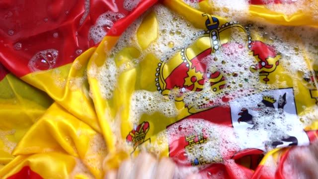 Hands Washing Spanish Flag - Change Spain/Corruption Concept