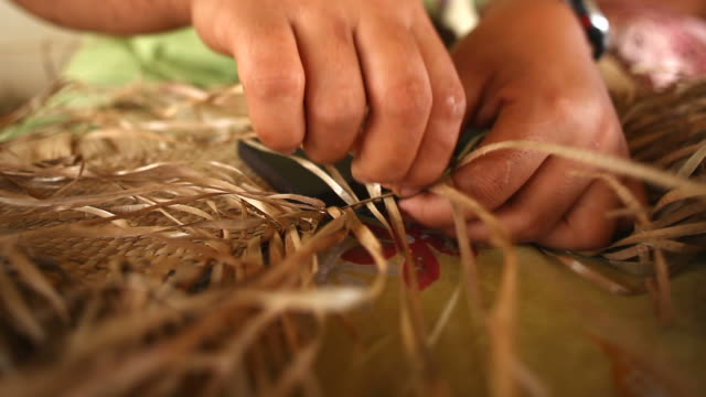 hands weaving a fine mat - polynesian culture stock videos and b-roll footage