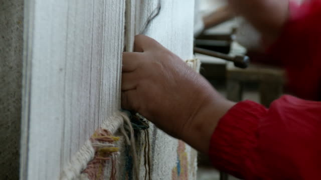 CU TU Hands weaving at Tibetan refugee center / Darjeeling, West Bengal, India