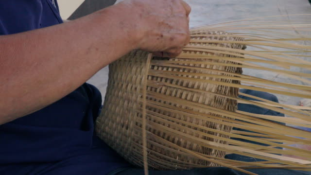 hands weaving bamboo basket, handmade by villagers from chiangmai, thailand. - wicker stock videos & royalty-free footage