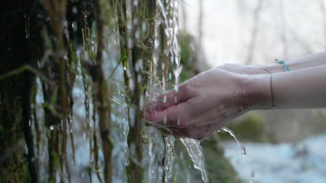 hands with crystal clear mountain water - harmony stock videos & royalty-free footage