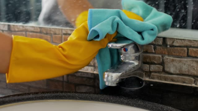 hands with gloves and rag cleaning in the bathroom - cleaner stock videos and b-roll footage