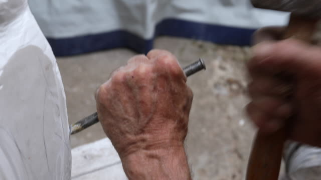hands with hammer and chisel - mallet hand tool stock videos and b-roll footage