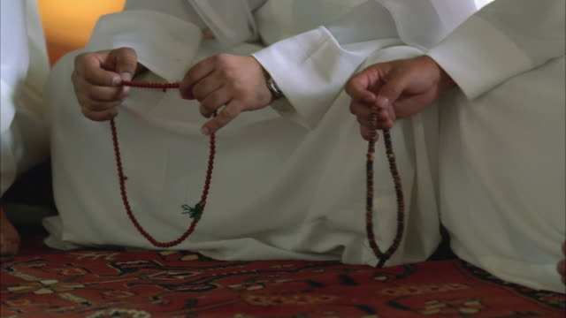 CU PAN Hands with prayer beads