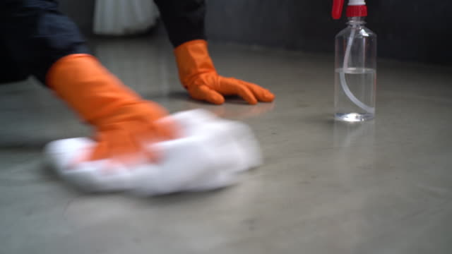hands with protective glove disinfecting concrete floor - washing up glove stock videos & royalty-free footage