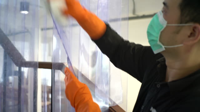 hands with protective glove disinfecting plastic curtain - washing up glove stock videos & royalty-free footage