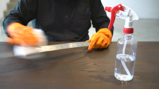 hands with protective gloves disinfecting surface - straccio video stock e b–roll