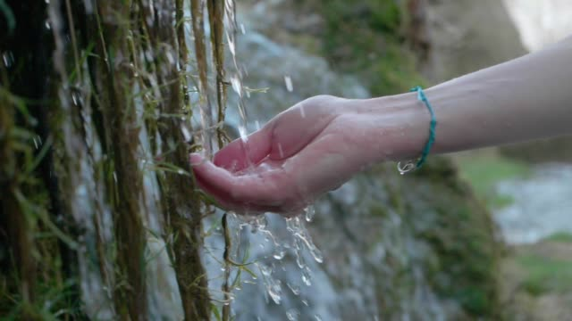 hands with pure spring water. crystal clear mountain water - refreshment stock videos & royalty-free footage