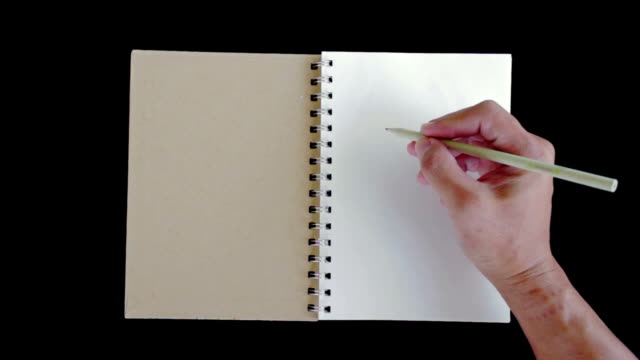 "hands writing ""hello""on the paper - diary stock videos & royalty-free footage"