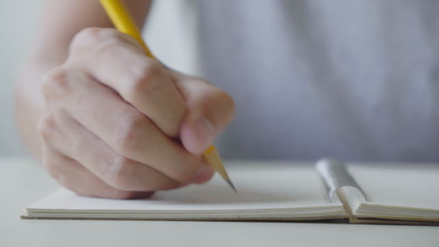 hands writing on the paper - list stock videos & royalty-free footage