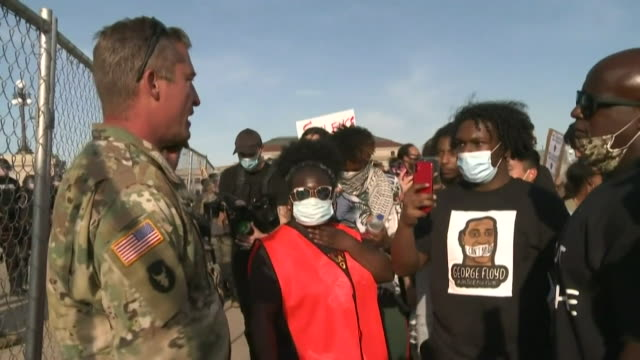 handshake and embrace between member of the national guard and protester at protest for george floyd, an african-american man who died while being... - white stock videos & royalty-free footage