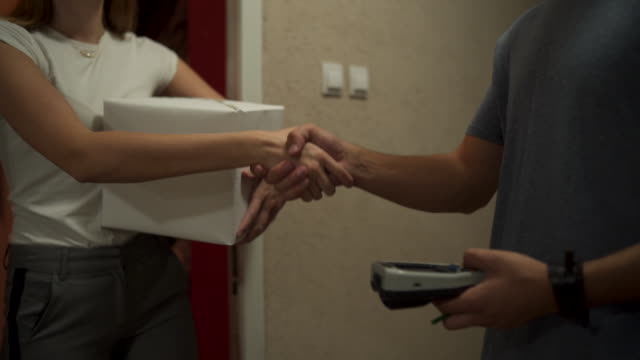 handshake between customer and delivery worker - receiving stock videos & royalty-free footage