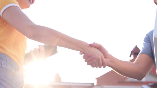 handshake between customer and female courier - receiving stock videos & royalty-free footage