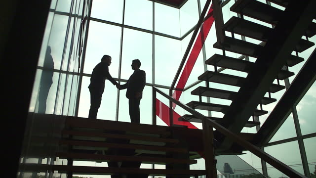handshake of businessman demonstrating their agreement to sign agreement or contract between their firms / companies / enterprises.shot with slow motion camera. - trust stock videos & royalty-free footage