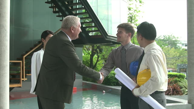 handshake of businesspeople demonstrating their agreement to sign agreement or contract between their firms / companies / enterprises. - dealing cards stock videos and b-roll footage