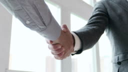 Handshaking in a office. Slow motion
