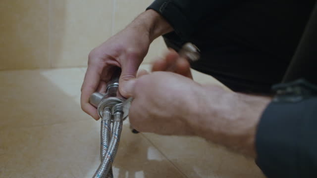 handsome active senior man repairing the sink in the kitchen. diy. home improvement. - bathroom stock videos & royalty-free footage