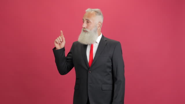 handsome adult businessman showing copy space and showing thumbs up on red background - big hair stock videos & royalty-free footage