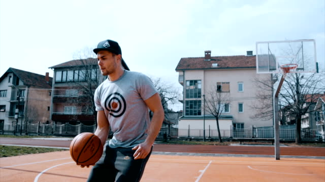 handsome athlete hits the basket behind his back - cap stock videos & royalty-free footage