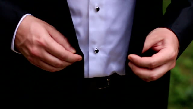 handsome businessman putting on suit jacket - suit jacket stock videos & royalty-free footage