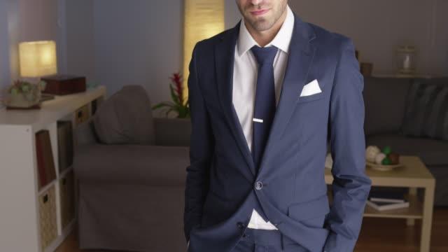 Handsome businessman standing looking confident