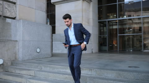 handsome businessman using mobile phone - slow motion 4k video - full suit stock videos & royalty-free footage