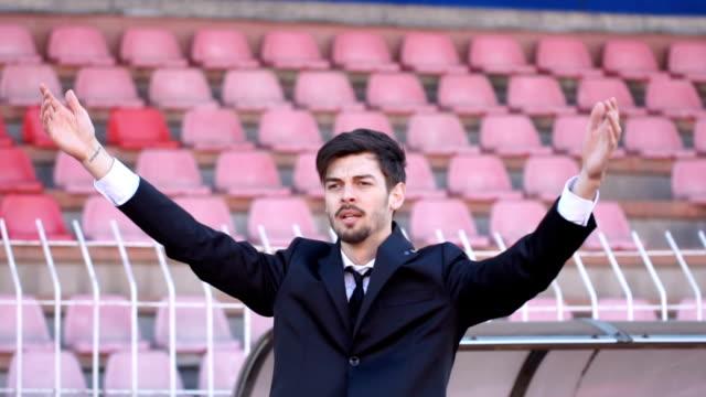 handsome coach doing his job - allenatore video stock e b–roll