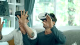 LGBT handsome couple enjoy playing virtual reality simulator for relaxation
