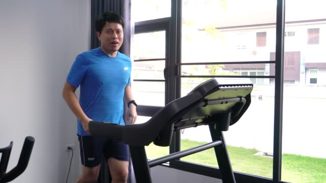 handsome fit man running on the treadmill. - treadmill stock videos & royalty-free footage