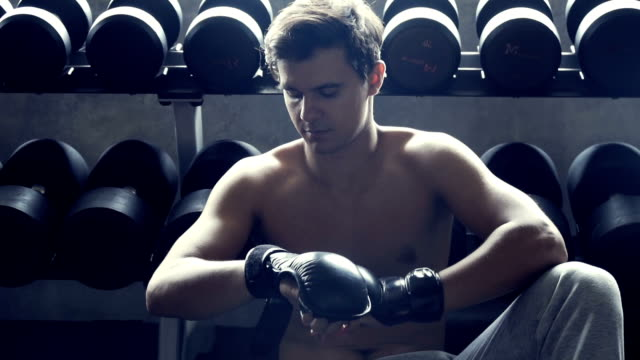 handsome fit sporty man boxing relax in dark gym - pampering self stock videos and b-roll footage