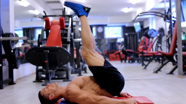 handsome fit sporty man does abdominal exercises in the gym - human limb stock videos & royalty-free footage