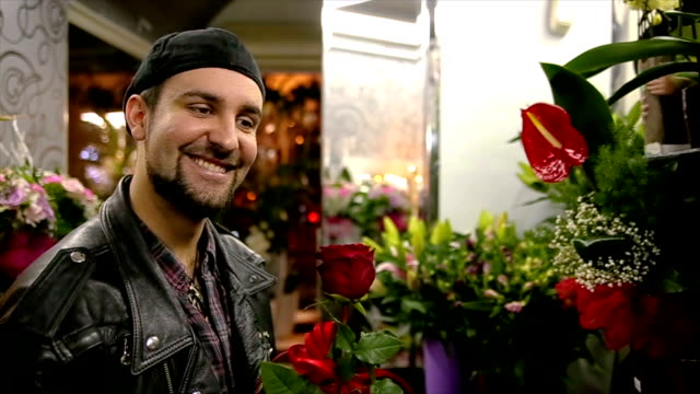 Handsome guy buying a rose for his girlfriend