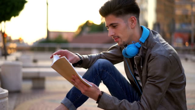 handsome guy reading a book - handsome people stock videos & royalty-free footage