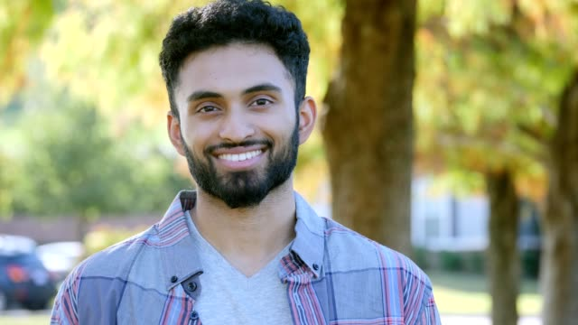 handsome male college student outdoors on campus - indian ethnicity stock videos & royalty-free footage