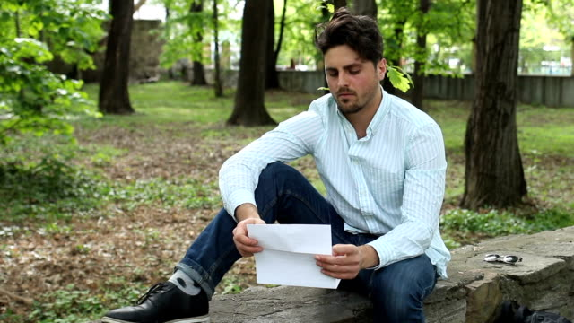 Handsome male reading a letter