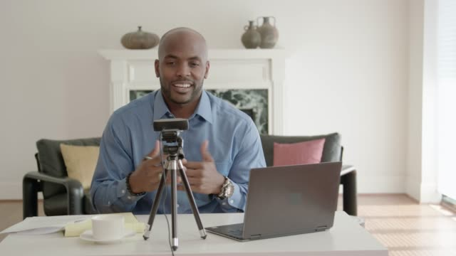 handsome man african-american vlogger recording a show - webcam stock videos & royalty-free footage