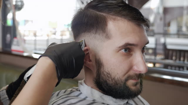 handsome man getting his head shaved by barber - cutting hair stock videos and b-roll footage