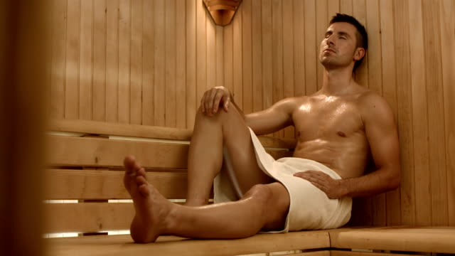 hd dolly: handsome man in the sauna - sauna stock videos & royalty-free footage
